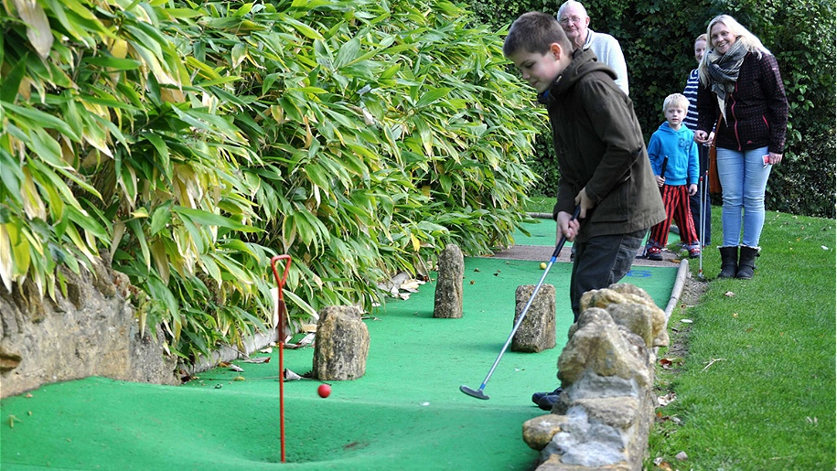 family playing crazy golf