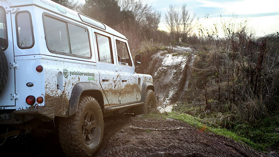 muddy off road land rover
