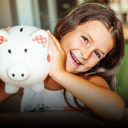 Lets Go With The Children Girl with piggy bank