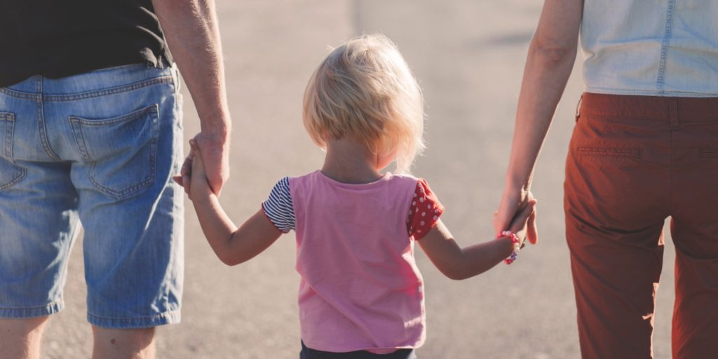 child walking with family