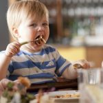 child eating spaghetti