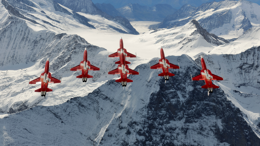 RNAS Yeovilton International Air Day Patrouille Suisse flying above mountains