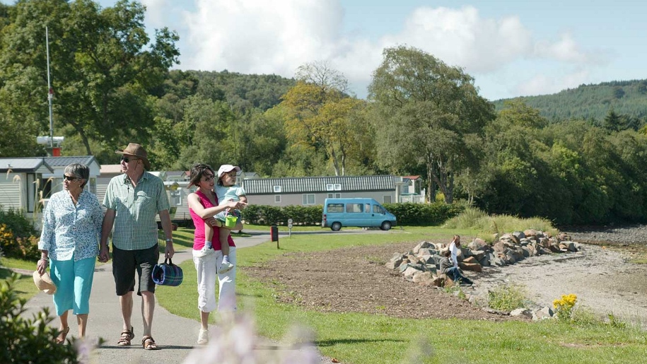 Argyll holidays family walking by caravans