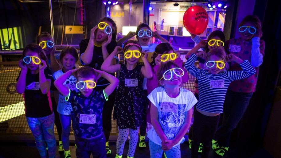 children in glow in the dark glasses and socks