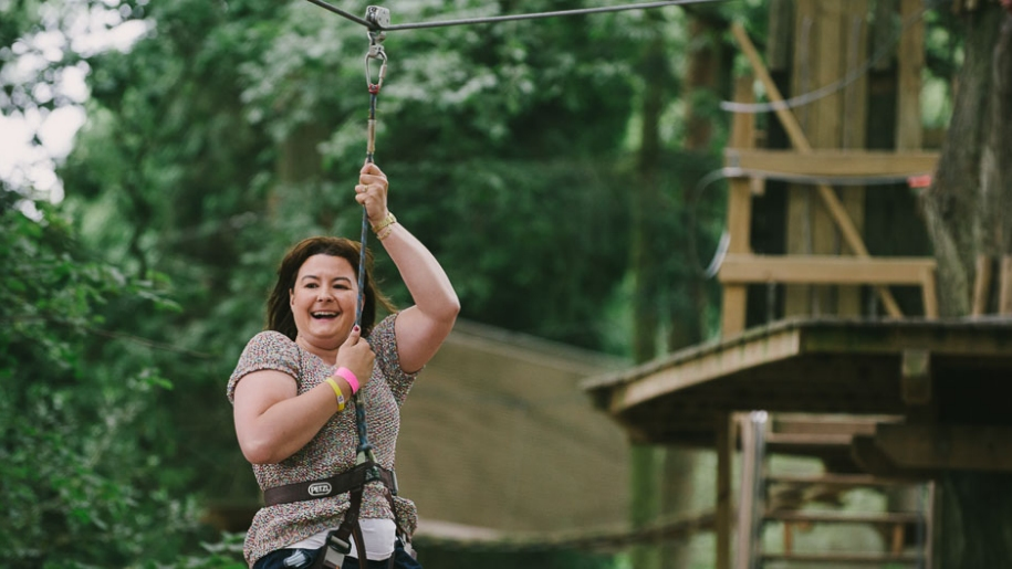 Go ape woman on zip wire