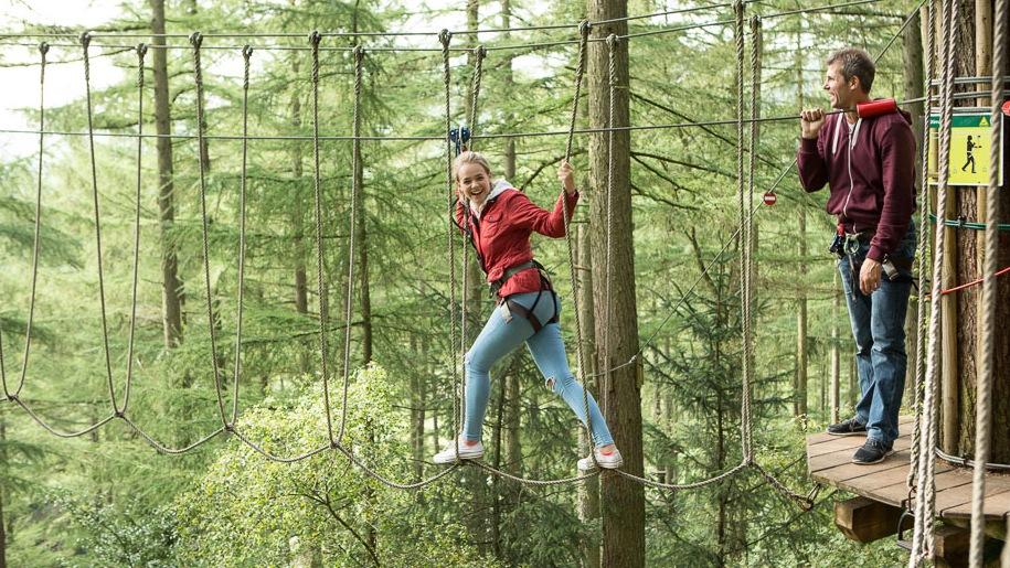 Go Ape girl walking on rope