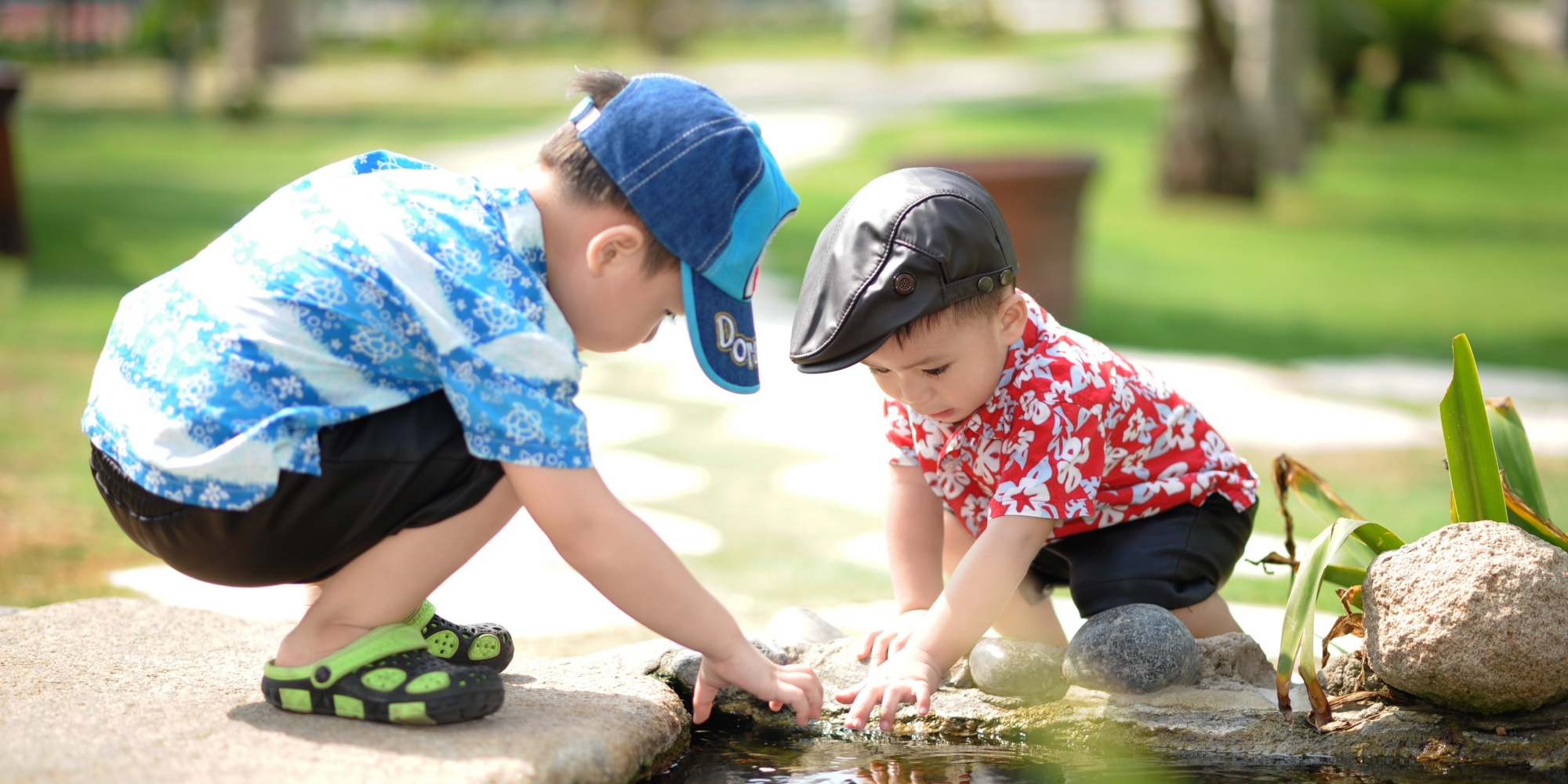 two boys looking in pond