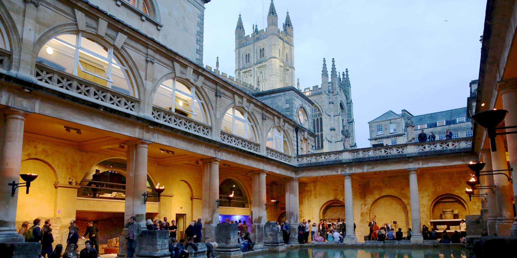 families at the Roman Baths at night time