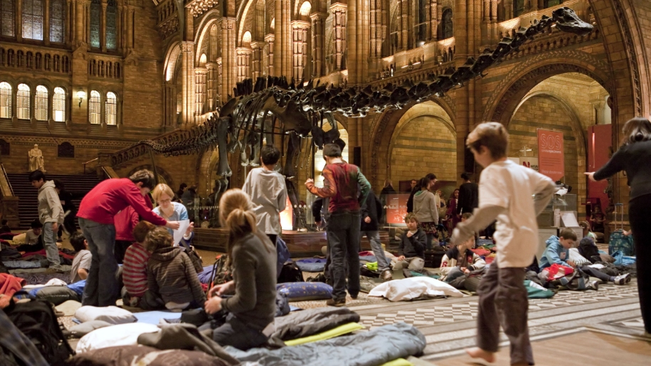 children in museum with sleeping bags