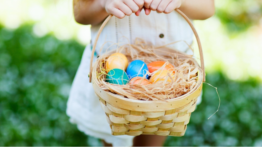 girl holding basket with easter eggs in