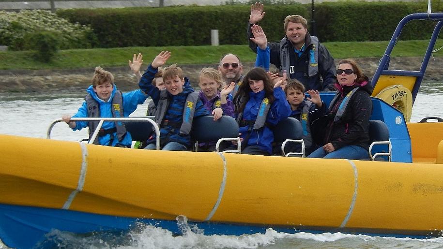 family enjoying boat ride