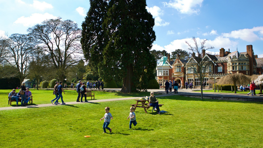 children playing in field outside Bletchley Park