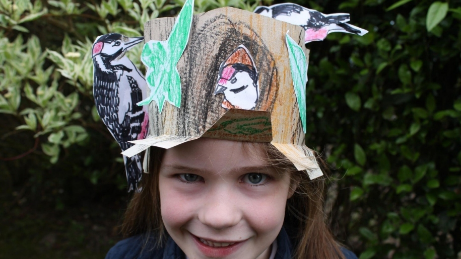 girl with paper hat of animals on her head