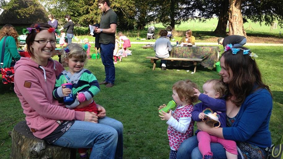 family sitting in park