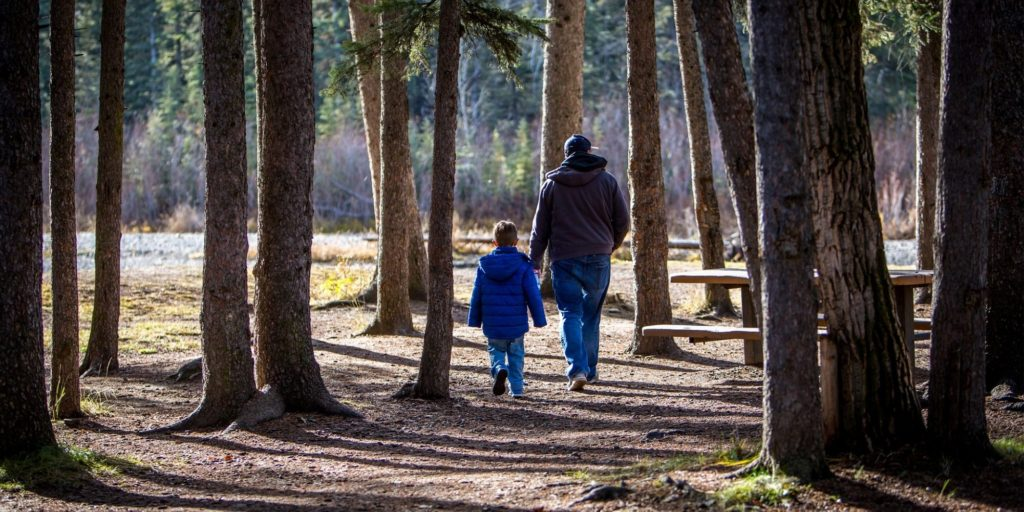 dad and son walking together