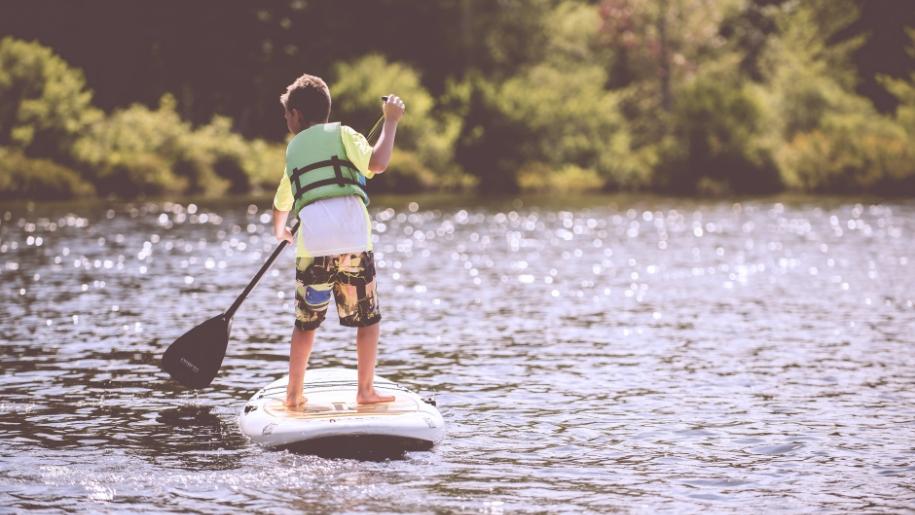 boy paddleboarding