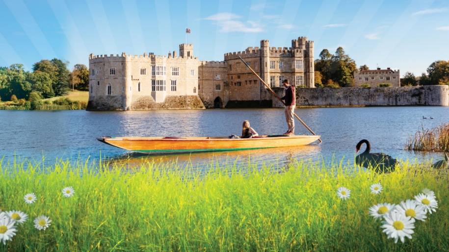 people on boat in front of Leeds Castle