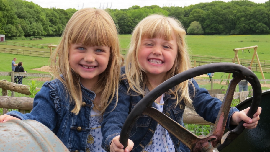 two girls on tractor