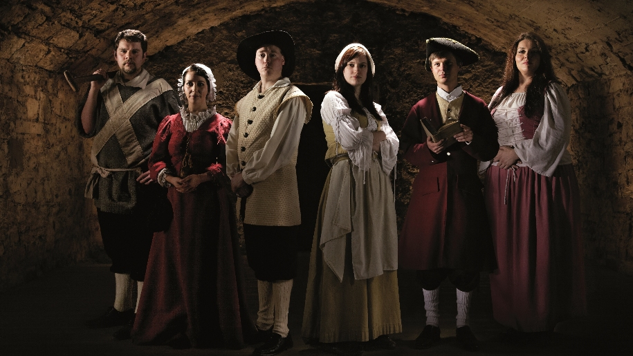 actors dressed in historical costume