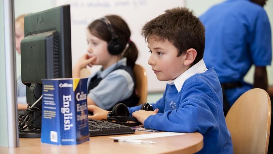 boy and girl at computer