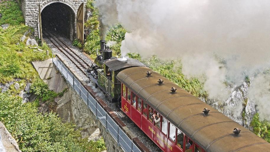 steam train going into tunnel
