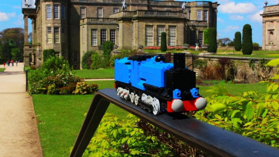 LEGO train in front of building