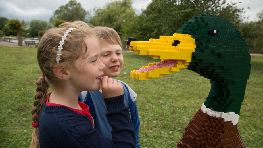 children looking at Lego Duck