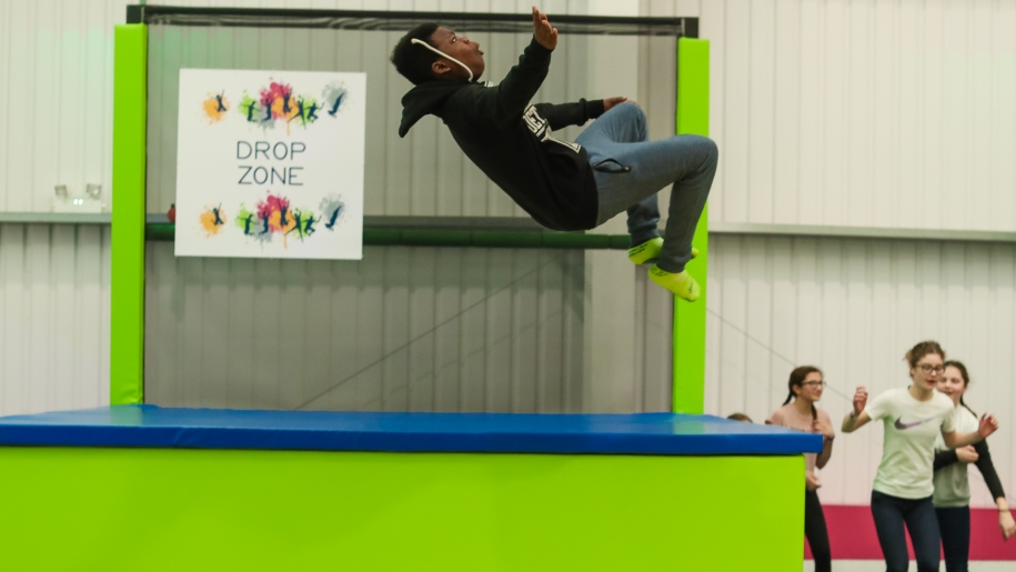 boy doing a flip on a trampoline