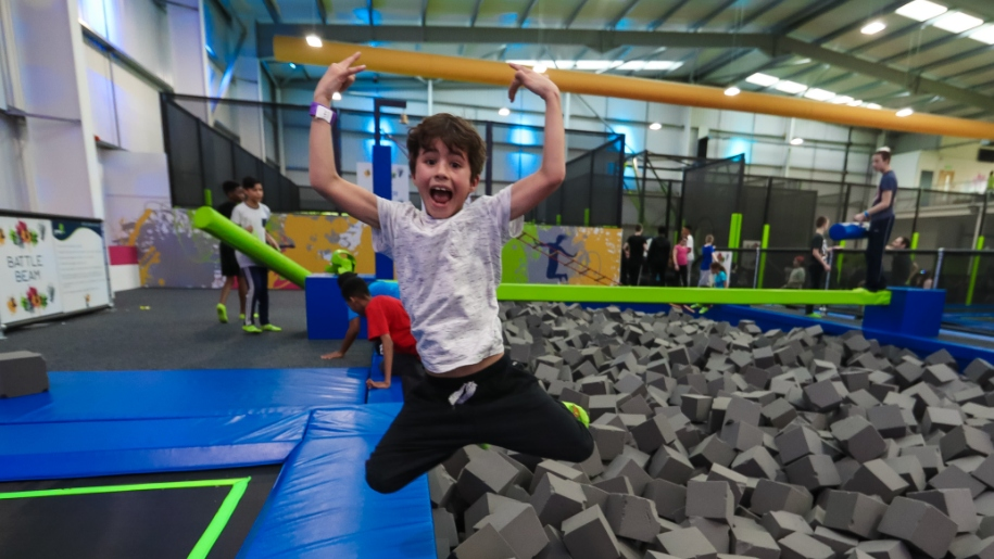 boy jumping into foam pit