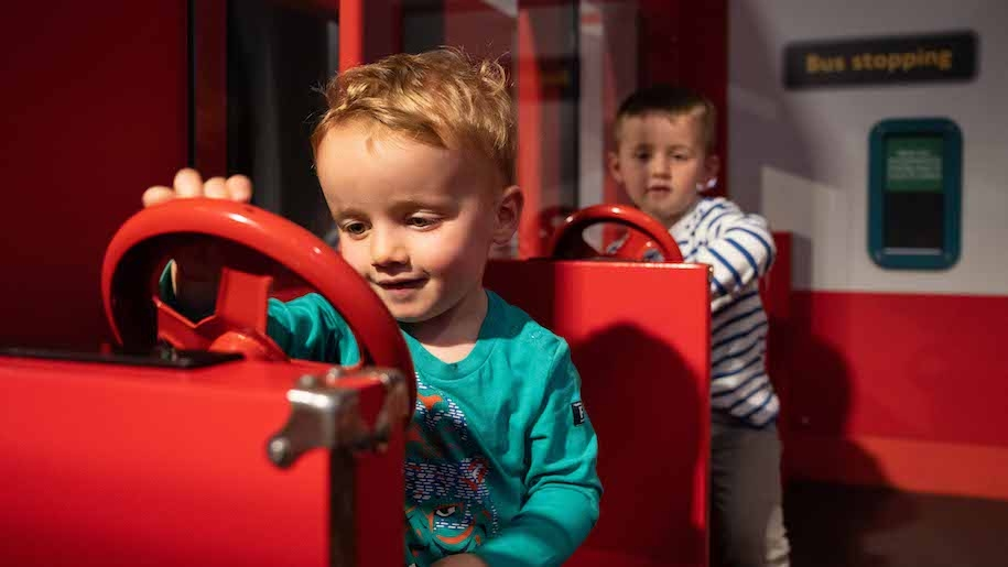 little boys playing trains at London Transport Museum