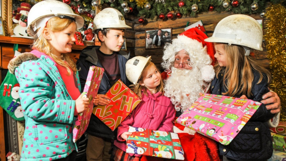 kids in mining hats with santa