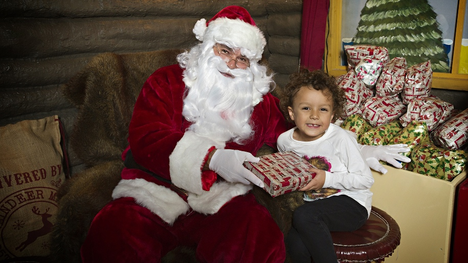 santa giving child a present