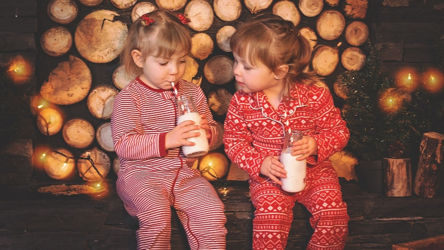 two girls with milk at christmas