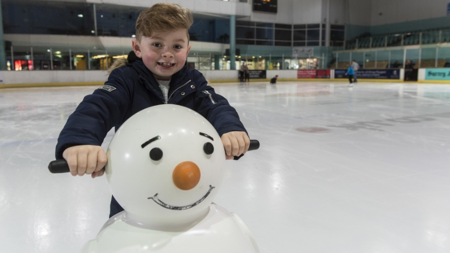 boy skating with snowman