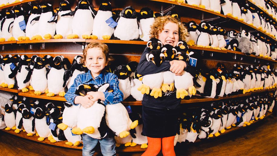 children with cuddly penguins