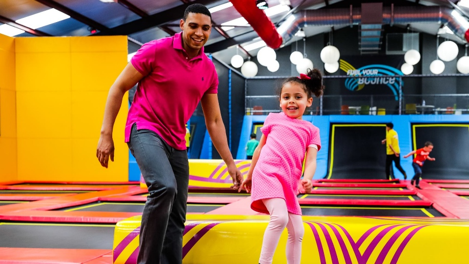 parent and child on trampoline