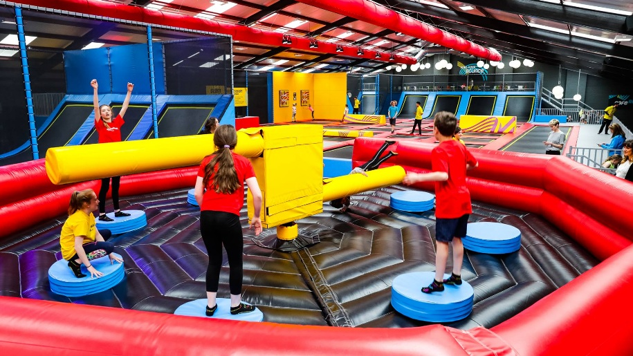 children on bouncy obstacle course