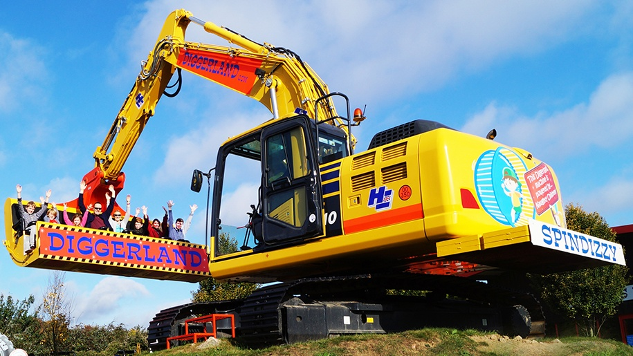 family on diggerland ride