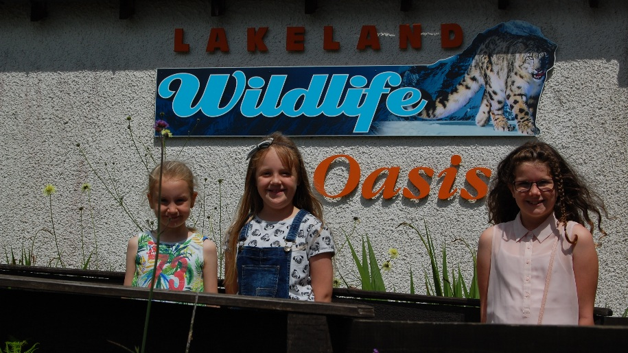 kids in front of wildlife sign