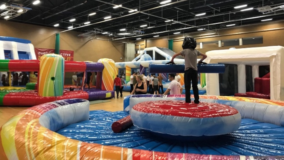 children on inflatable obstacle course
