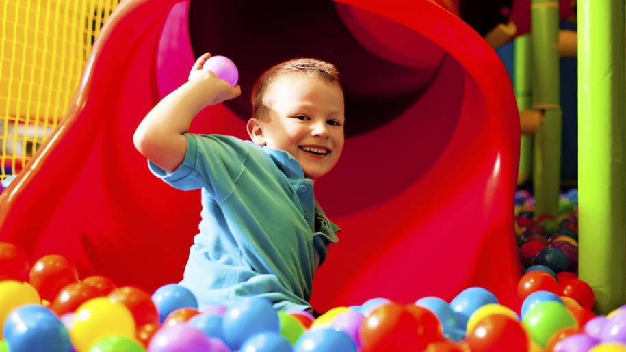 boy in ball pit