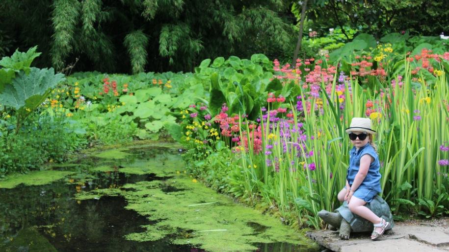 girl sitting by pond