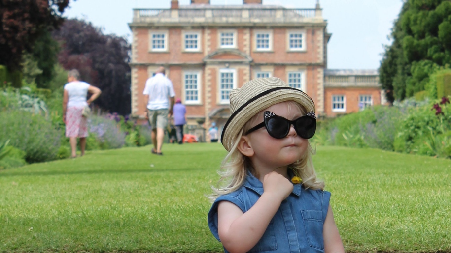 girl sitting in front of newby hall
