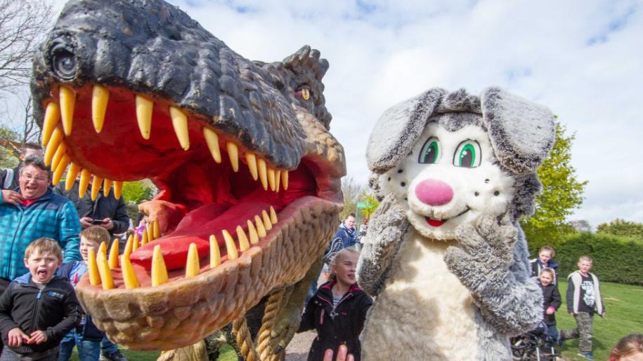 dinosaur with bunny