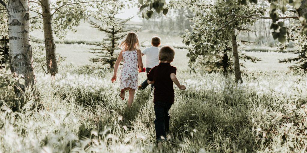 kids running in field of flowers