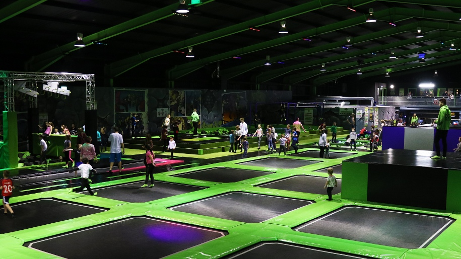 indoor trampoline park filled with children