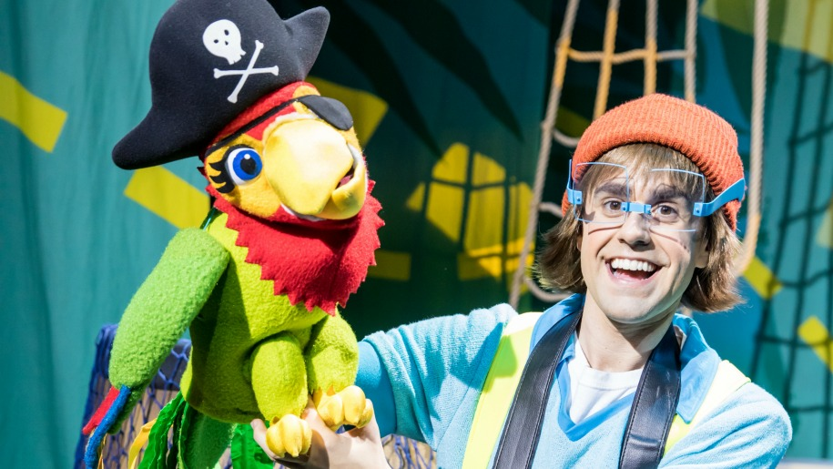 parrot character and man dressed as pirate on stage