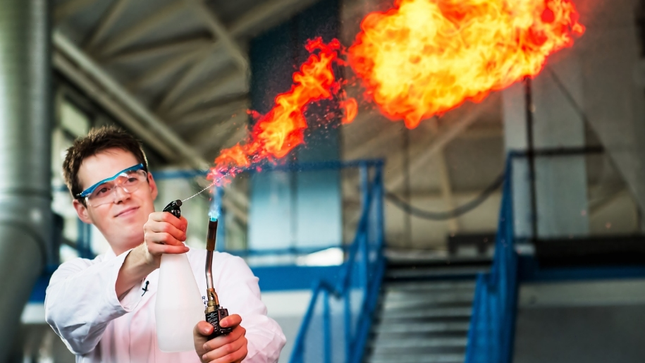 man with flames for science experiment