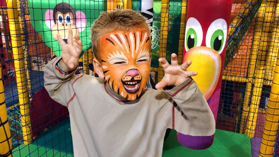 boy with tiger face paint at Gambado