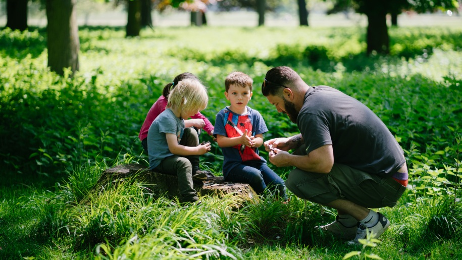 dad wiht kids in wood at Holkham